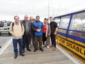 Seven people on Poole Quay
