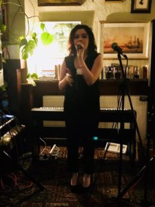 Amie Bedford singing at her event