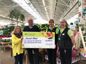 Simon Hallam from Haskins Garden Centre presents cheque
