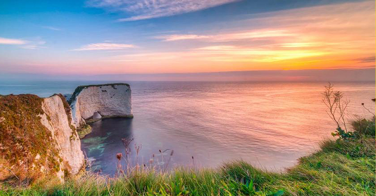 Dorset Landscape Showing Cliffs And Sea