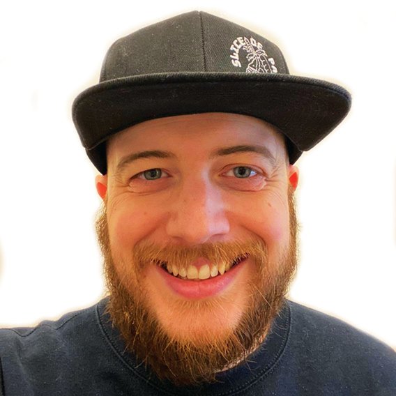 Photo of a male smiling ambassador with a cap on