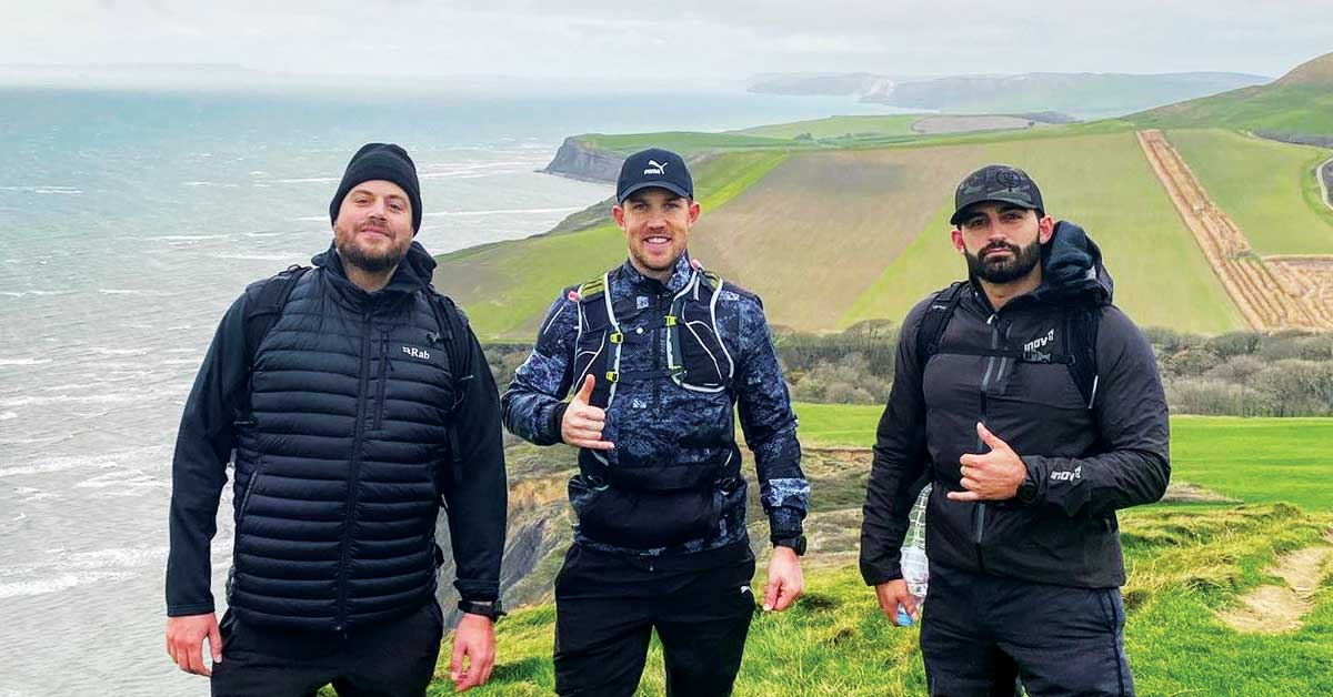 Three Leaders Of The Step Up Challenge Stand On The Coastline